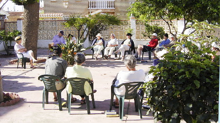 Photo of a group discussion in the hostel's garden