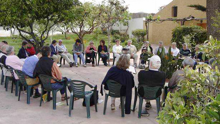 Group in the garden at a seminar in a conversation